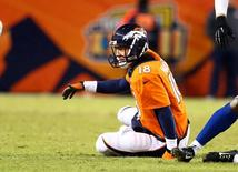 Denver Broncos quarterback Peyton Manning reacts as he sits on the ground after being sacked in the second half against the Indianapolis Colts in the 2014 AFC Divisional playoff football game at Sports Authority Field at Mile High. Mark J. Rebilas- Jan 11, 2015; Denver, CO, USA; USA TODAY Sports