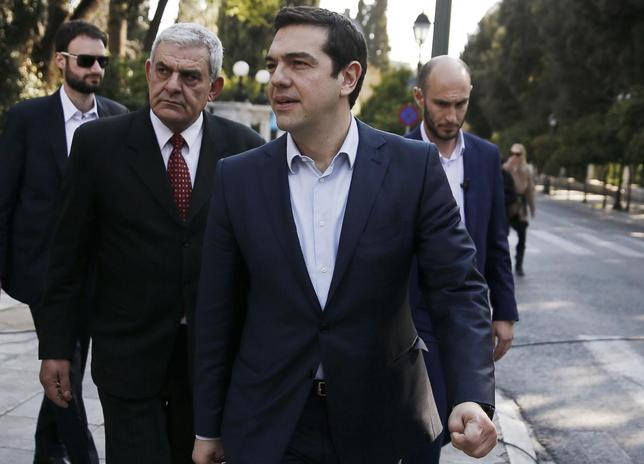 Greek Prime Minister Alexis Tsipras (C) exits the Presidential Palace after attending a dinner hosted by outgoing Greek President Karolos Papoulias in honour of newly-elected President Prokopis Pavlopoulos, in Athens March 4, 2015.  REUTERS/Alkis Konstantinidis