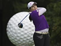 Park In-bee of South Korea hits off the sixth tee during the first round of the LPGA Canadian Women's Open golf tournament in Coquitlam, British Columbia August 23, 2012.   REUTERS/Andy Clark