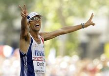 Yohann Diniz from France celebrates after winning the men's 50 km walk at the European Athletics Championships in Barcelona July 30, 2010. REUTERS/Albert Gea