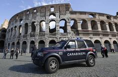 A carabinieri paramilitary car patrols in front of the Colosseum in Rome February 17 , 2015.  REUTERS/Max Rossi