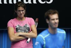Amelie Mauresmo, coach of Britain's Andy Murray (R), watches him during a practice session on Margaret Court Arena at Melbourne Park January 18, 2015. REUTERS/Carlos Barria