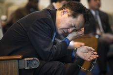 A man takes part in a prayer service for Reverend Hyeon Soo Lim, inside a chapel at the Light Korean Presbyterian Church in Mississauga, March 9, 2015.   REUTERS/Mark Blinch