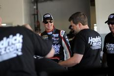 NASCAR Sprint Cup Series driver Kurt Busch (C) speaks to members of his crew next to his number 51 car in the garage area at Daytona International Speedway in Daytona Beach, Florida, February 24, 2012. REUTERS/Brian Blanco