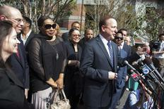 Nona Gaye (2nd L), daughter of late singer Marvin Gaye, and her lawyer Richard Busch (front R) speak to the media outside court in Los Angeles, California March 10, 2015.  REUTERS/Lucy Nicholson