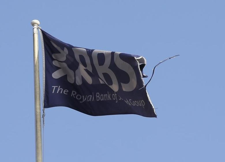 A flag flies above the head office of the Royal Bank of Scotland (RBS) in St Andrew Square in Edinburgh, Scotland September 11, 2014. REUTERS/Russell Cheyne
