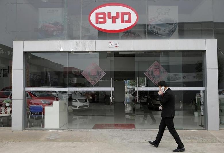 A man walks past a BYD store in Wuhan, Hubei province, March 20, 2014.  REUTERS/Stringer
