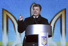 "Ukraine's President Petro Poroshenko addresses the commemoration for people from the so-called ""Heavenly Sotnya"" (Hundred), who were killed in anti-government protests in 2014, at Independence Square in Kiev February 20, 2015. REUTERS/Valentyn Ogirenko"