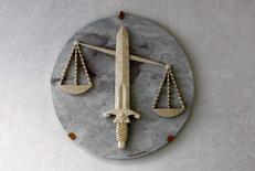 Le Parquet national financier a ouvert le 16 février une information judiciaire visant la Banque Pasche, filiale suisse du Crédit Mutuel-CIC, selon une source judiciaire. /Photo d'archives/REUTERS/Eric Gaillard