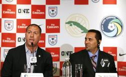 Giovanni Savarese (L), Head Coach of the New York Cosmos of the North American Soccer League and Walter Benitez (R), Head Coach of the Cuban national team attend a news conference in New York, March 16, 2015. REUTERS/Mike Segar