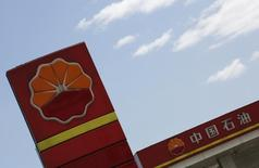 "PetroChina's logo are seen at its gas station in Beijing, August 29, 2013. China oil construction company Wison Engineering Services Co Ltd said its chairman and controlling shareholder Hua Bangsong ""is assisting relevant authorities"" in China who are conducting an investigation after sharp falls in Wison's share price. Wison, which counts PetroChina among its major customers, did not elaborate on the investigation. It said it issued the statement after Chinese media reports about its business relationship with PetroChina. To match Story CHINA-WISON/PROBE Picture taken August 29, 2013. REUTERS/Kim Kyung-Hoon (CHINA - Tags: BUSINESS ENERGY LOGO)"
