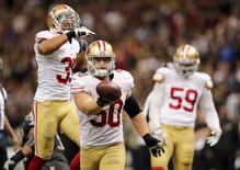Nov 9, 2014; New Orleans, LA, USA; San Francisco 49ers inside linebacker Chris Borland (50) celebrates after a fumble by New Orleans Saints quarterback Drew Brees (not pictured) in overtime at Mercedes-Benz Superdome. The 49ers won 27-24. Mandatory Credit: Chuck Cook-USA TODAY Sports