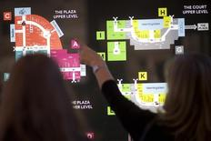 Shoppers refer to a map at the King of Prussia Mall in Pennsylvania; a  2.7 million square feet shopping destination owned by Simon Property Group. Picture taken December 6, 2014.  REUTERS/Mark Makela