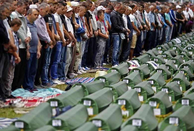 Bosnian Muslims pray during a mass funeral for 175 newly identified victims from the 1995 Srebrenica massacre, at Potocari Memorial Center, near Srebrenica July 11, 2014. REUTERS/Dado Ruvic