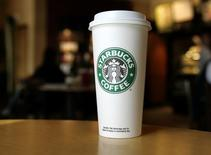 A cup displaying the Starbucks Coffee logo is pictured at one of the coffee chain's store in Boca Raton, Florida January 19, 2010. REUTERS/Joe Skipper