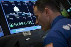 Herbalife ticker is seen at the post where its stock is traded on the floor of the New York Stock Exchange March 10, 2014.  REUTERS/Brendan McDermid