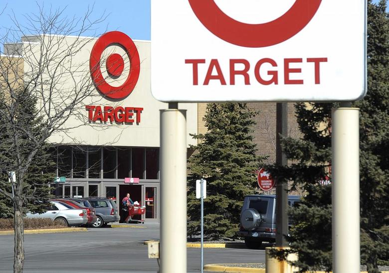 A shopper leaves a Target store after Target announced that 3,100 positions would be eliminated, in St Louis Park, Minnesota March 10, 2015.   REUTERS/Craig Lassig