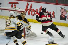 Mar 19, 2015; Ottawa, Ontario, CAN; Ottawa Senators center Kyle Turris (7) skates past Boston Bruins goalie Tuukka Rask (40) in the third period at the Canadian Tire Centre. The Senators defeated the Bruins 6-4. Mandatory Credit: Marc DesRosiers-USA TODAY Sports