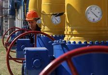 Дожимная компрессорная станция в Харьковской области. 5 августа 2014 года. Украина в четверг перечислила российскому Газпрому вторую на этой неделе предоплату в размере $15 миллионов, сообщила Рейтер пресс-секретарь украинского импортера госкомпании Нафтогаз в пятницу. REUTERS/Konstantin Grishin