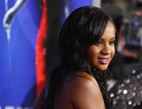 """Bobbi Kristina Brown, daughter of the late singer Whitney Houston, poses at the premiere of """"Sparkle"""" in Hollywood, California August 16, 2012. REUTERS/Fred Prouser/Files"""