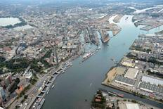 General view of the harbour of Hamburg with construction site of the Philharmonic Hall and Harbour City, September 23, 2012.  REUTERS/Fabian Bimmer