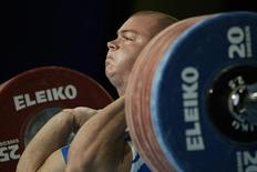Milen Dobrev of Bulgaria lifts 220.5 kilograms in the clean and jerk category in group A of the men's 94 kilogram weight class at the World Weightlifting Championship in Vancouver, British Columbia, November 20, 2003. REUTERS/Lyle Stafford/Files