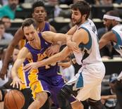 Feb 4, 2014; Minneapolis, MN, USA; Minnesota Timberwolves point guard Ricky Rubio (9) tries to steal the ball from Los Angeles Lakers guard Steve Nash (10) in the fourth quarter at Target Center. Brad Rempel-USA TODAY Sports