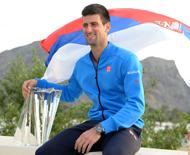 Novak Djokovic (SRB) with the championship trophy after he defeated Roger Federer (SUI) 6-3, 6-7, 6-2 in the finals of the BNP Paribas Open at the Indian Wells Tennis Garden. Mandatory Credit: Jayne Kamin-Oncea-USA TODAY Sports