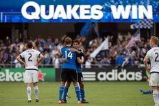 San Jose Earthquakes forward Chris Wondolowski (8) hugs forward Adam Jahn (14) after the win against the Chicago Fire during the second half at Avaya Stadium. The San Jose Earthquakes defeated the Chicago Fire 2-1. Mandatory Credit: Kelley L Cox-USA TODAY Sports