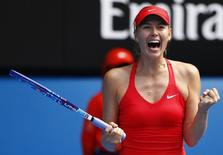 Maria Sharapova of Russia celebrates after defeating compatriot Ekaterina Makarova in their women's singles semi-final match at the Australian Open 2015 tennis tournament in Melbourne January 29, 2015.  REUTERS/Issei Kato