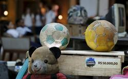 Toys collected in the Guanabara Bay is pictured in the exhibition Achados da Guanabara, or Found in Guanabara at the Leblon mall in Rio de Janeiro March 24, 2015. REUTERS/Sergio Moraes