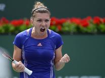 Simona Halep (ROM) reacts during her match against Jelena Jankovic (SRB) in the finals of the BNP Paribas Open at the Indian Wells Tennis Garden. Halep won 2-6, 7-5, 6-4. Jayne Kamin-Oncea-USA TODAY Sports