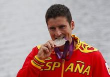 David Cal Figueroa of Spain celebrates his silver medal after the men's canoe single (C1) 1000m final at Eton Dorney at the London 2012 Olympics Games near London, August 8, 2012.  REUTERS/Jim Young