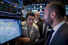 Traders work on the floor of the New York Stock Exchange March 25, 2015. REUTERS/Brendan McDermid
