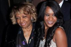 "Cissy Houston and Bobbi Kristina Brown (R) attend the opening night of ""The Houstons: On Our Own"" in New York in this October 22, 2012 file photo. REUTERS/Andrew Kelly"