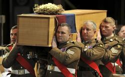 The coffin of King Richard III is carried by the military bearer party during the service of reinterment for his remains at Leicester Cathedral in Leicester, England in this March 26, 2015 handout photo by Leicester Cathedral.  REUTERS/Will Johnston/Leicester Cathedral/Handout via Reuters