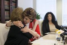 Sunni Welles and attorney Gloria Allred (C) hug as Margie Shapiro (R) looks on during a news conference to allege that Welles and Shapiro believe that they were drugged and sexually assaulted by Bill Cosby, in Los Angeles, California March 27, 2015.  REUTERS/David McNew