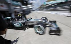Mercedes' Nico Rosberg pulls out of the garage during practice. REUTERS/ Olivia Harris
