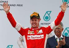 Formula One - F1 - Malaysian Grand Prix 2015 - Sepang International Circuit, Kuala Lumpur, Malaysia - 29/3/15 Ferrari's Sebastian Vettel celebrates winning the Malaysian Grand Prix on the podium Reuters / Olivia Harris