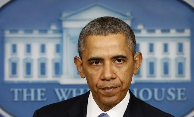 U.S. President Barack Obama pauses while speaking about the crisis in Ukraine from the White House in Washington March 17, 2014. REUTERS/Kevin Lamarque