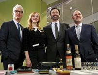 """Mad Men"" stars (L-R) John Slattery, Christina Hendricks and Jon Hamm along with series creator Matthew Weiner (R) stand behind props from the show during a donation ceremony at the Smithsonian National Museum of American History in Washington March 27, 2015. REUTERS/Kevin Lamarque"