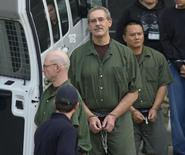 Allen Stanford (C) leaves the Federal Courthouse where the jury found him guilty, in Houston March 6, 2012.  REUTERS/Donna W. Carson