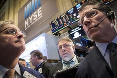 Traders work on the floor of the New York Stock Exchange March 26, 2015. REUTERS/Brendan McDermid