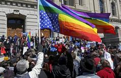 Demonstrators gather at Monument Circle to protest a controversial religious freedom bill recently signed by Governor Mike Pence, during a rally in Indianapolis March 28, 2015.  REUTERS/Nate Chute