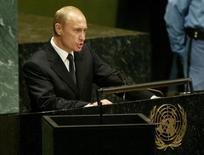 Президент России Владимир Путин выступает на 58-й сессии Генассамблеи ООН в Нью-Йорке. 25 сентября 2003 года. Владимир Путин допускает поездку в Нью-Йорк на юбилейное заседание Генеральной Ассамблеи ООН, где лишь 11 стран-членов из 193 признали законным референдум в Крыму, после которого Россия аннексировала украинский полуостров. REUTERS/Jim Bourg