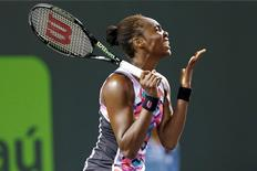 Mar 31, 2015; Key Biscayne, FL, USA; Venus Williams reacts to missing a shot against Carla Suarez Navarro (not pictured) on day nine of the Miami Open at Crandon Park Tennis Center. Navarro won 0-6, 6-1, 7-5. Mandatory Credit: Geoff Burke-USA TODAY Sports