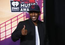 Hip hop recording artist Kendrick Lamar poses backstage during the iHeartRadio Music Awards in Los Angeles, California May 1, 2014.   REUTERS/Mario Anzuoni