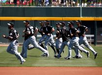 Mar 27, 2015; Mesa, AZ, USA; Chicago White Sox players warm up before a spring training game against the Chicago Cubs at Sloan Park. Mandatory Credit: Rick Scuteri-USA TODAY Sports