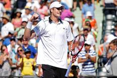 John Isner celebrates after his match against Kei Nishikori (not pictured) in a men's singles quarter-final on day eleven of the Miami Open at Crandon Park Tennis Center. Isner won 6-4, 6-3. Mandatory Credit: Geoff Burke-USA TODAY Sports