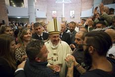 Pope Francis meets prisoners at Rebibbia's jail in Rome during the Holy Thursday, April 2, 2015.  REUTERS/Osservatore Romano